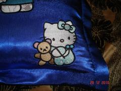 A pillow with Hello Kitty and Tippy the Bear: detail