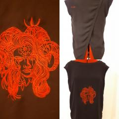 Horny demon with pictograph on forehead embroidery design