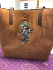 Embroidered bag with rootman in hat