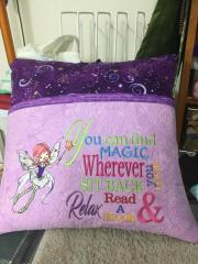 Embroidered pillow with flying fairy design