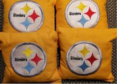 Embroidered pillow with Pittsburgh Steelers logo