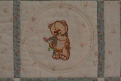 Teddy bear with flower embroidery design