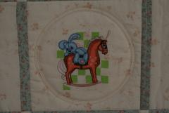 Rabbit in horse embroidery in quilt