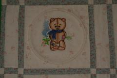 Old toys embroidered in quilt