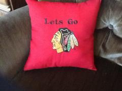 Embroidered pillow with blackhawk logo