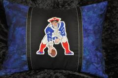 A pillow decorated with New England Patriots logo: detail