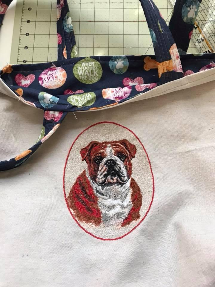 Embroidered bag bulldog in oval frame
