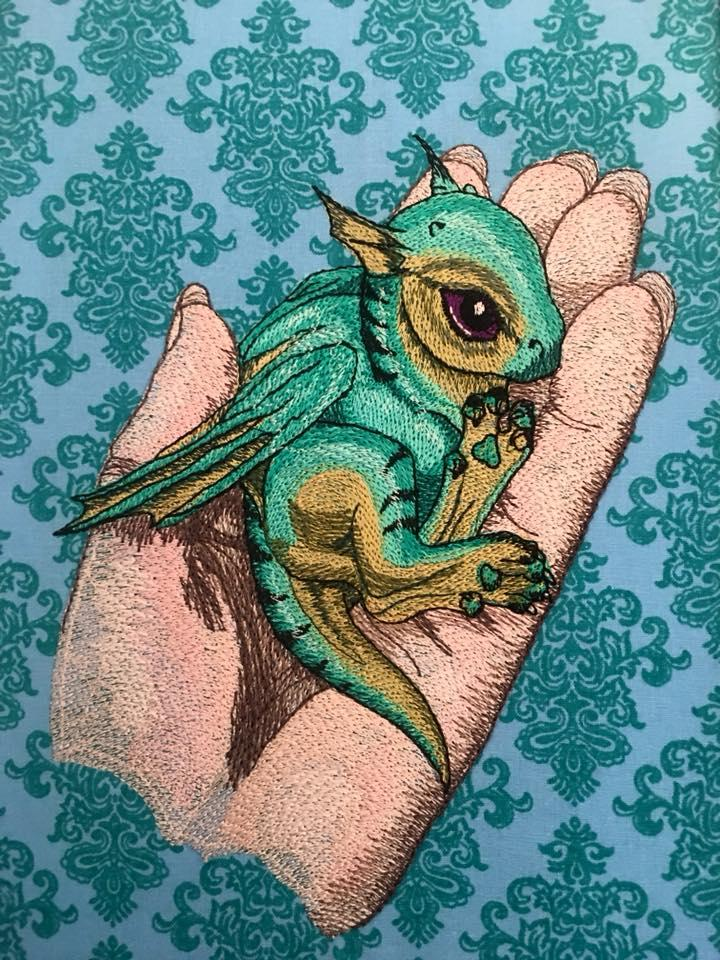 Embroidered Little dragon on hand design