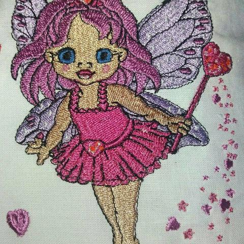 Cross stitch embroidered designs