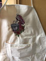 Embroidered apron with kneading machine design