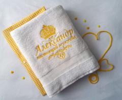 Embroidered towel with golden crown design