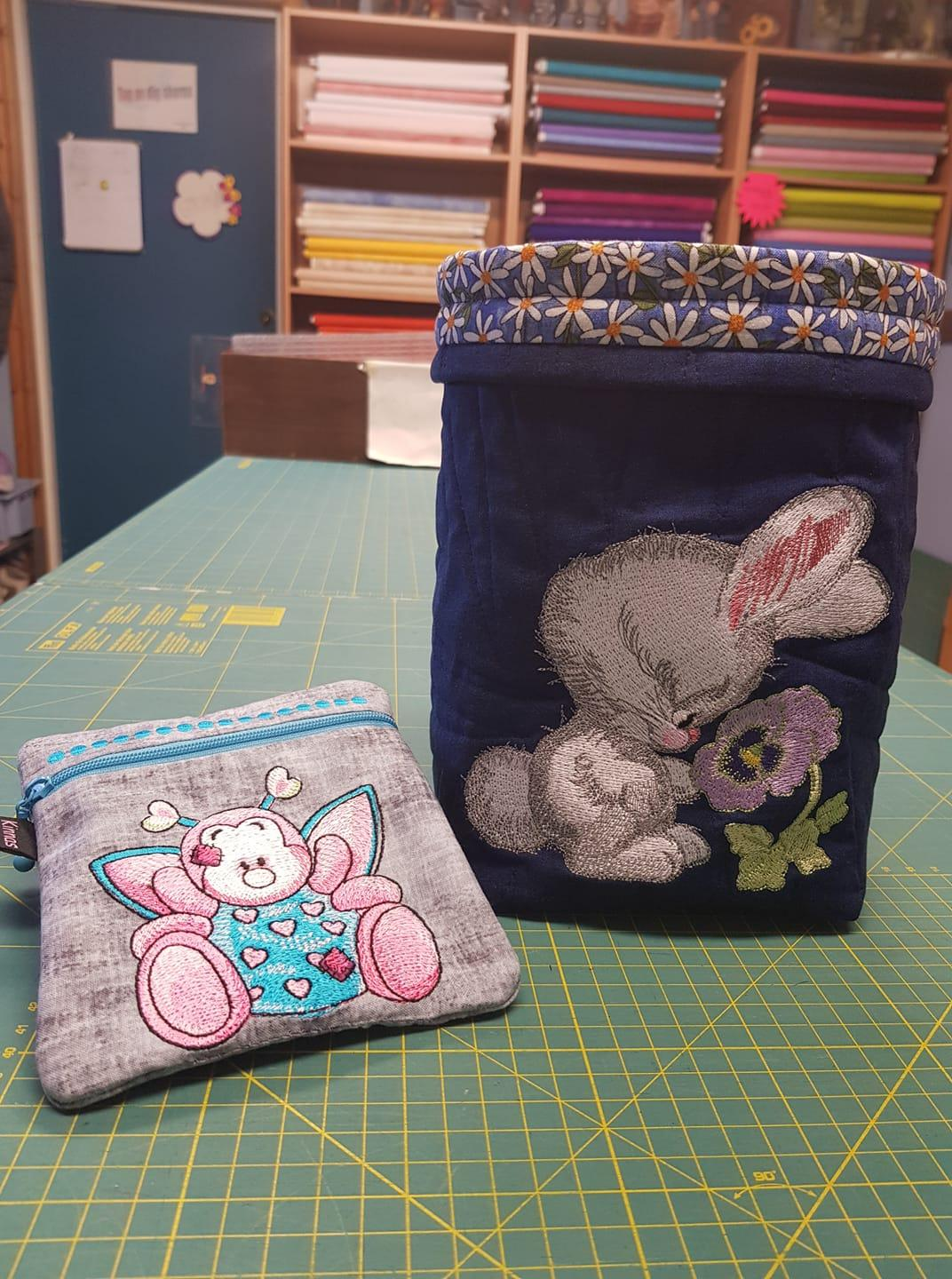 Embroidered cases with bunny and bee designs