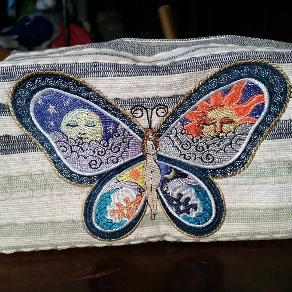 Embroidered towel with night and day butterfly free design