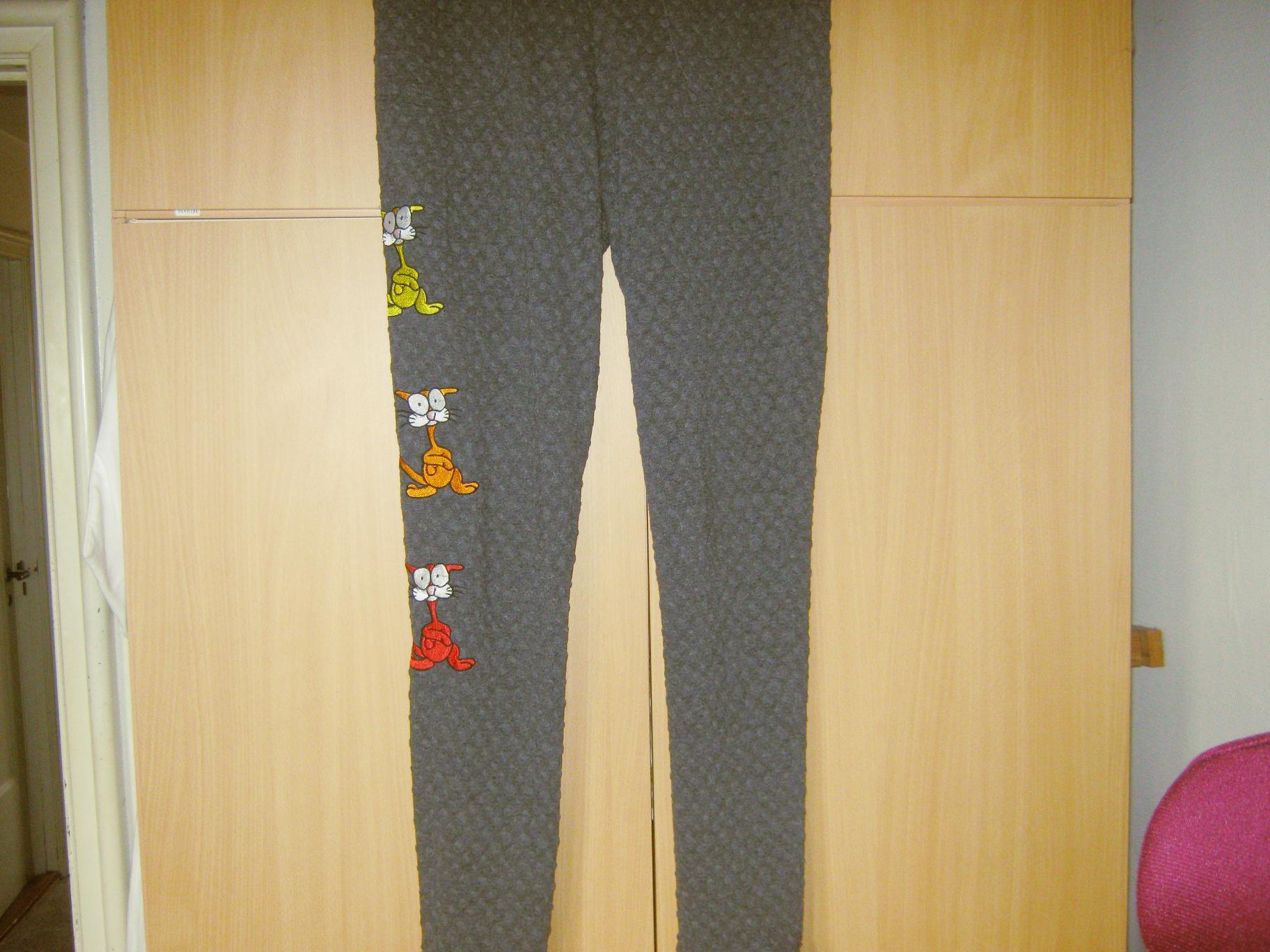 Embroidered trousers with crazy cat design