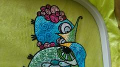 Fragment of grouсhy owls embroidery design