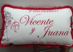 Embroidered cushion with passionate kiss free design
