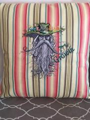 Embroidered cushion with root man design
