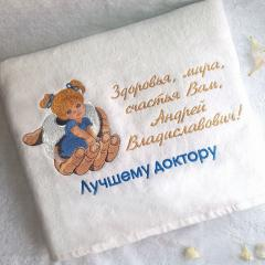 Embroidered towel with angel on palm design