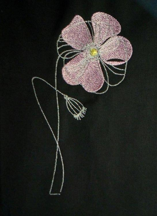 Pink flower free machine embroideyr design