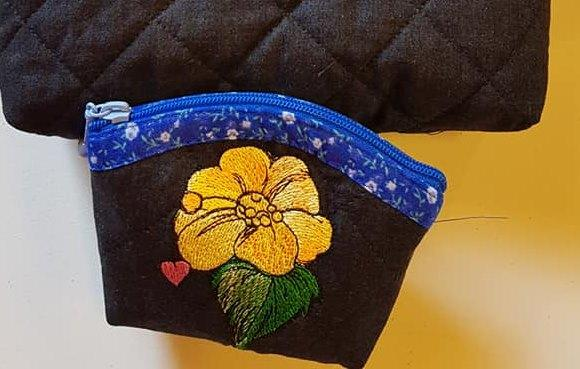 Embroidered handbag with yellow flower