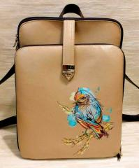 Close up embroidered backpack European goldfinch
