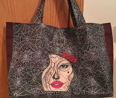 Embroidered bag girls' tears design