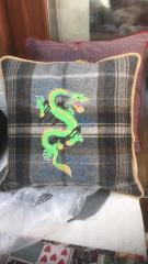 Embroidered cushion with green dragon free design