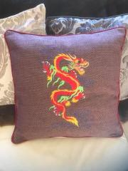 Embroidered cushion with oriental dragon free design