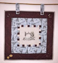 Embroidered panno with retro sewing machine design