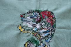 Lizard on tree branch embroidery design
