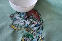 Lizard on tree branch embroidery design close up