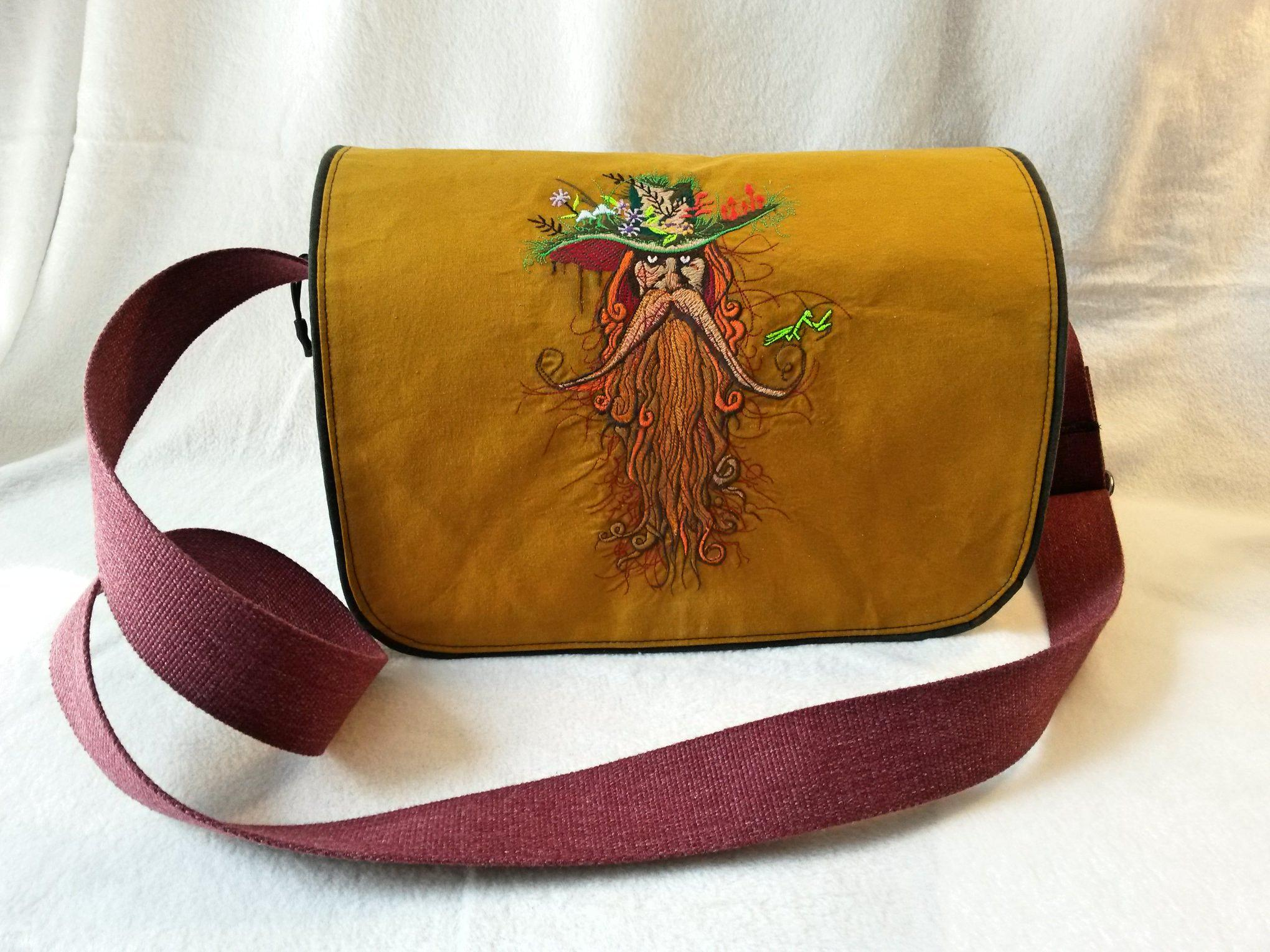 Embroidered bag with root man design