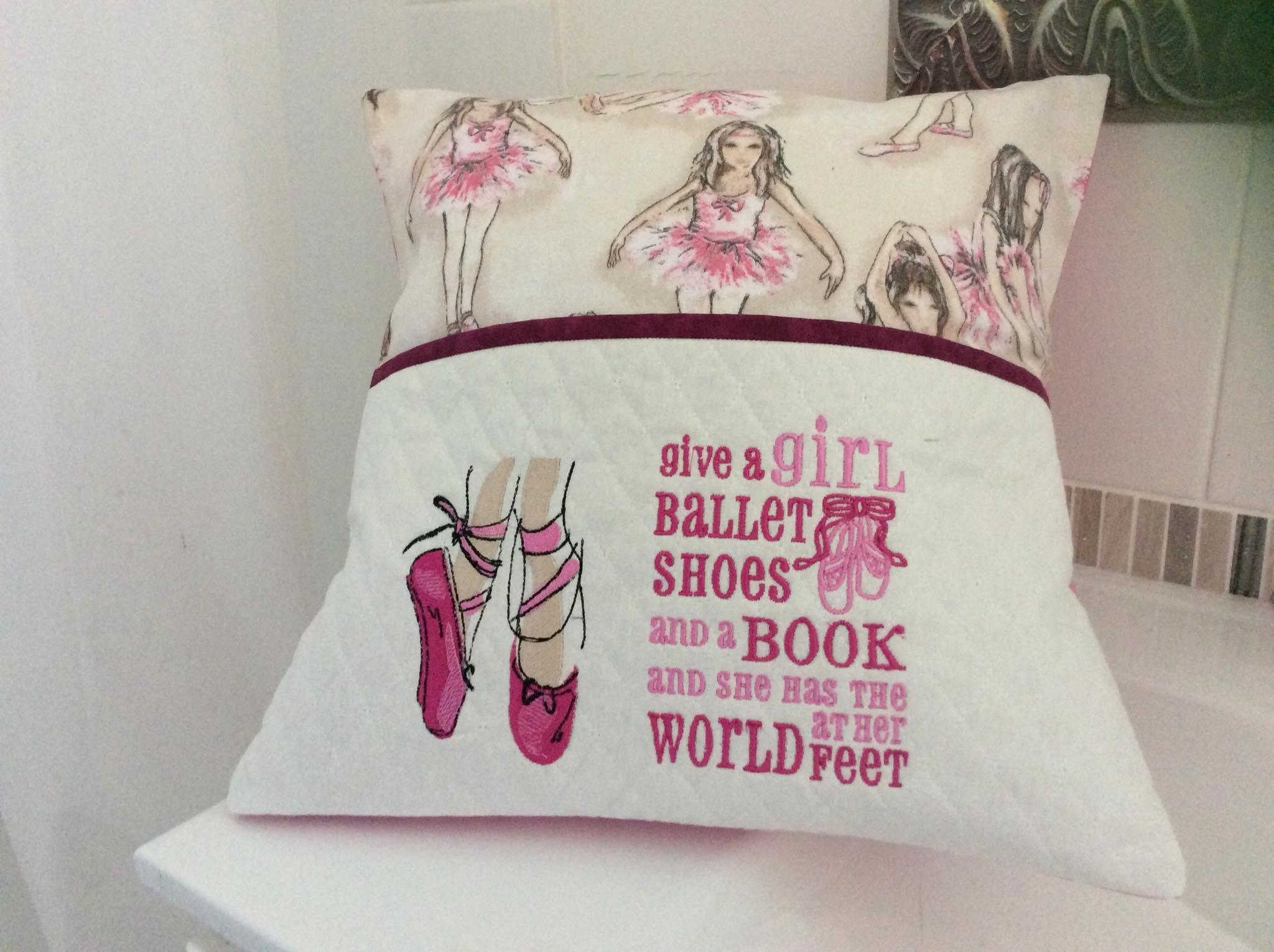 Embroidered cushion with pink pointes design