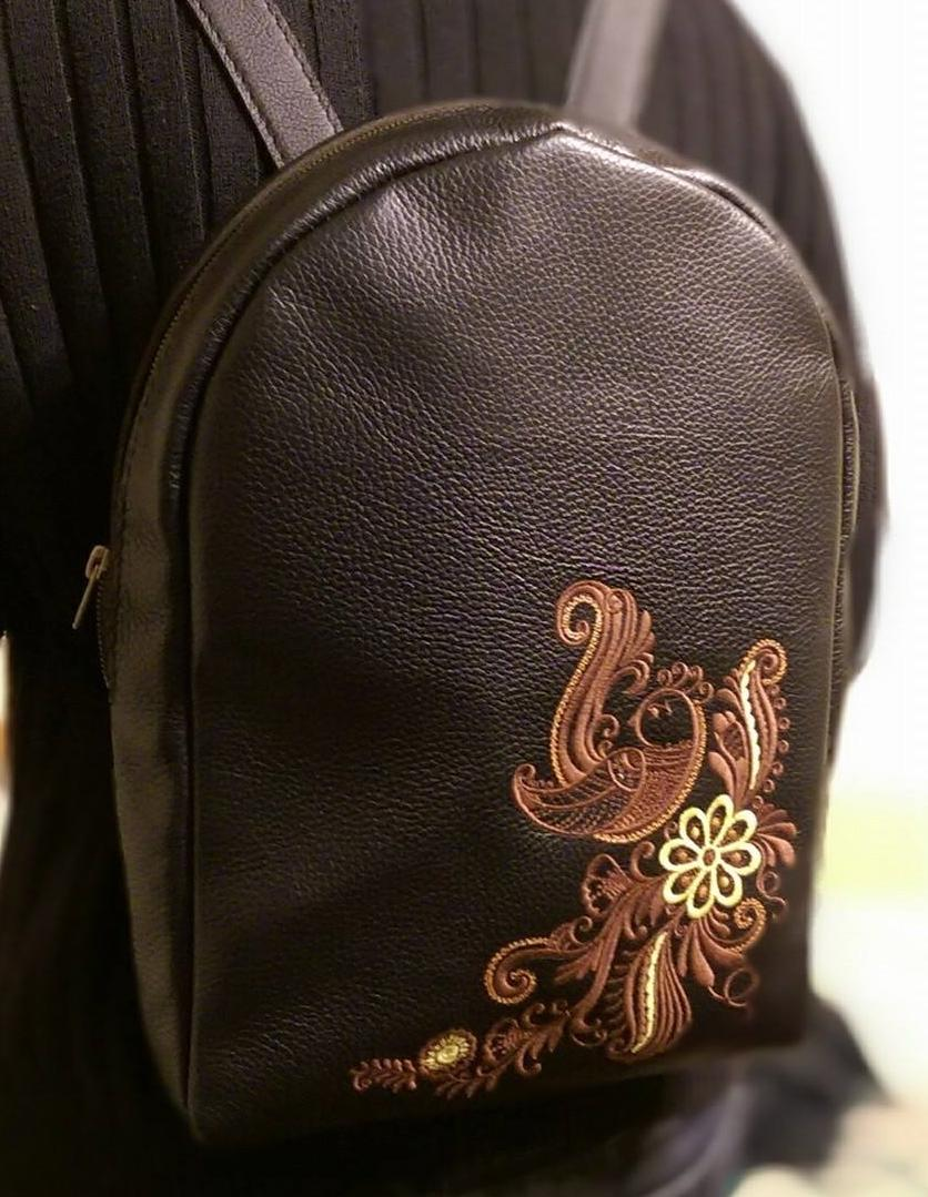 Embroidered backpack with firebird in flowers