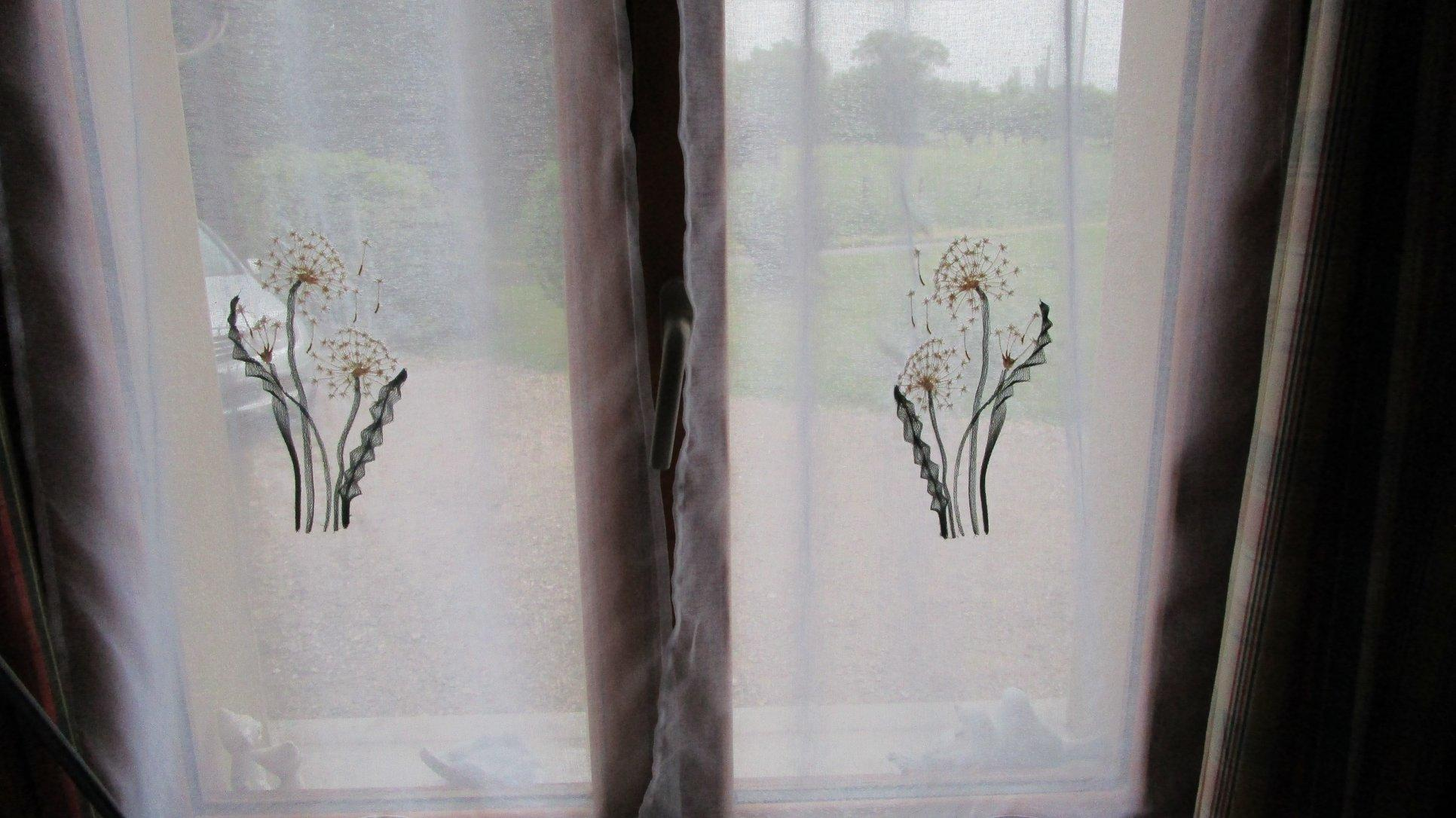 Embroidered curtains with light dandelions free design