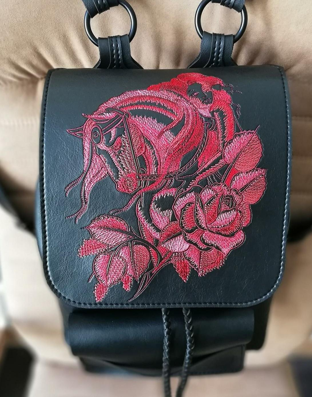 Close up embroidered backpack horse with flowers design