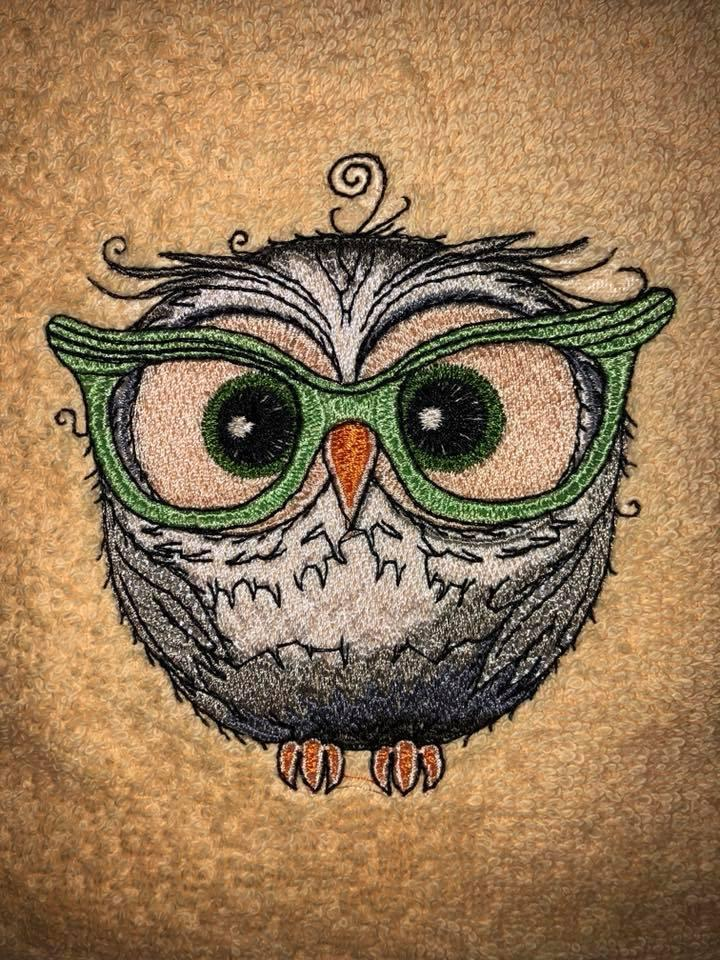 Close up owl in glasses embroidery design