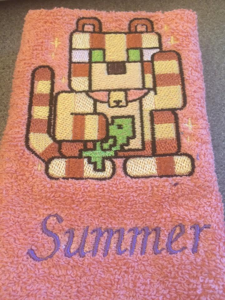 Embroidered towel with stylized cat