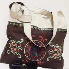 Embroidered bag with free floral ornament