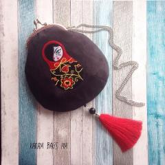 Embroidered bag with nesting doll design