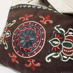 Floral ornament free embroidery design at bag