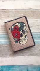 Document cover with skull and flowers embroidery design