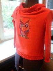 Colored owl on a sweater machine embroidery design