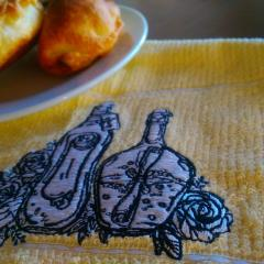 Bottles and flowers embroidered napkin