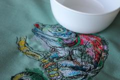 Close up colored lizard embroidery design