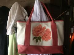 Beautifully leather bag with red rose free embroidery design