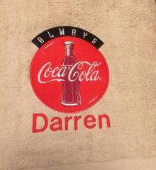 Embroidered towel with Coca-Cola