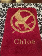 Embroidered towel with Hunger games logo