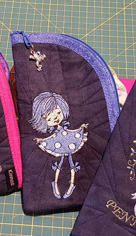Embroidered case with girl in polka dot dress