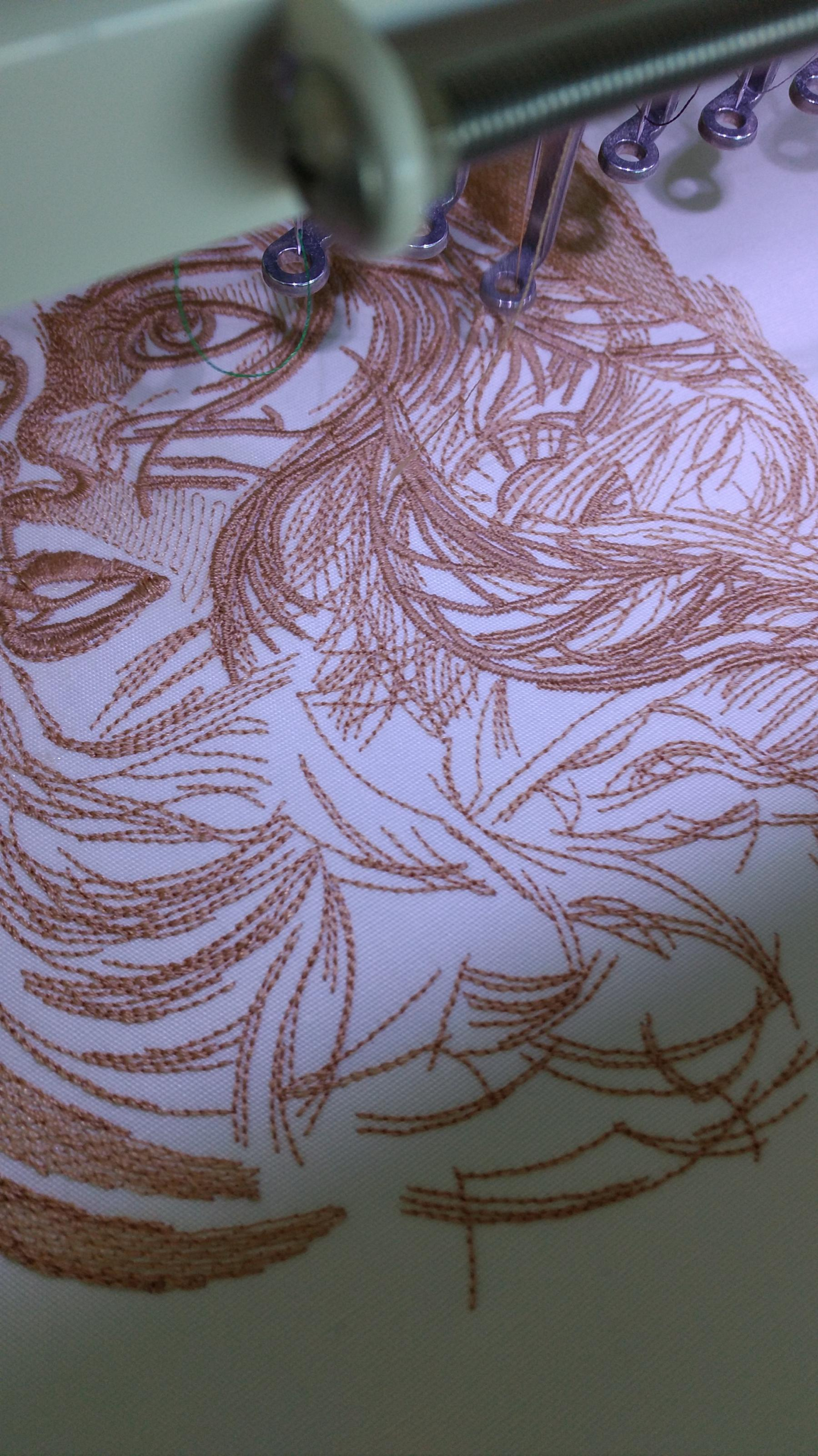 Work under young woman portrait embroidery design
